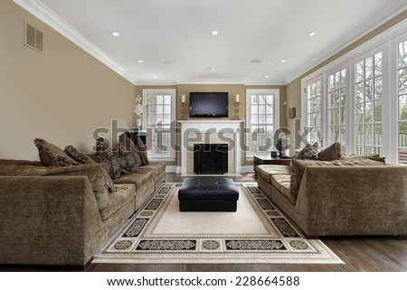 Family room in luxury home with wall of windows - stock photo