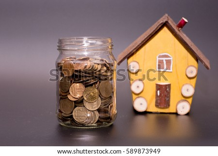 Family Saving Money For Buying House