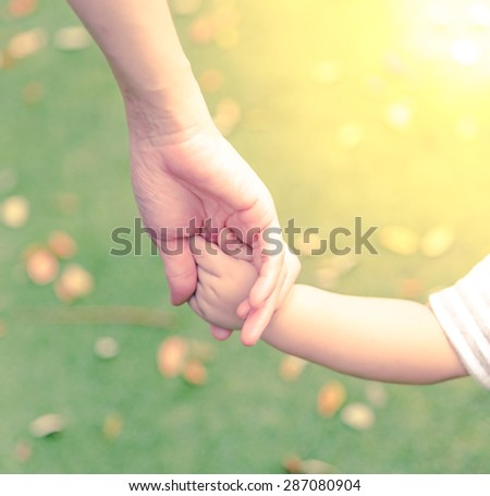 Family scene , closeup parent and baby holding hand together  - stock photo