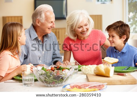 Family sharing meal - stock photo