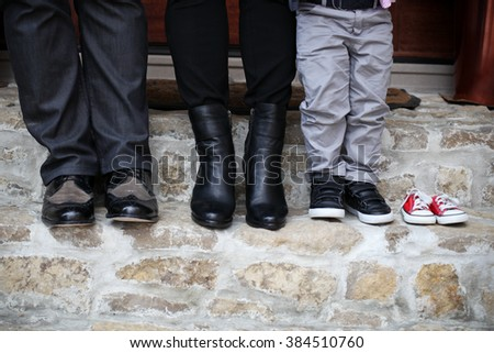 family shoes with new unborn baby shoes - stock photo