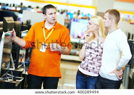 family shopping at electronics supermarket - stock photo