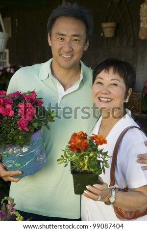 Family Shopping for Plants - stock photo