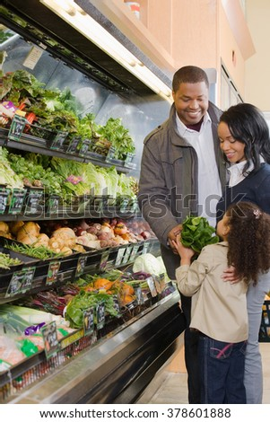 family shopping in a supermarket - stock photo