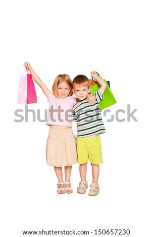 Family shopping. Young couple, a boy and a girl, hugging and holding shopping bags,  ready for your text, logo or symbols. Holiday Sale. Isolated on white background. - stock photo