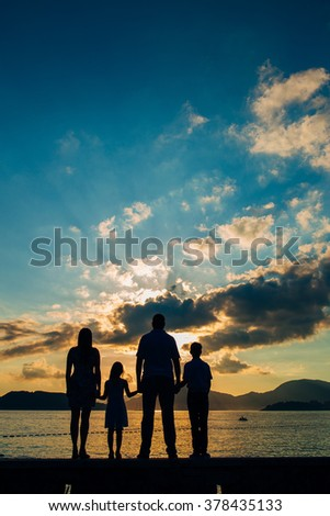 Family silhouette in the sunset