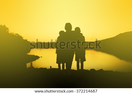 family  silhouette,Moments of the child's joy. On the Nature sunset
