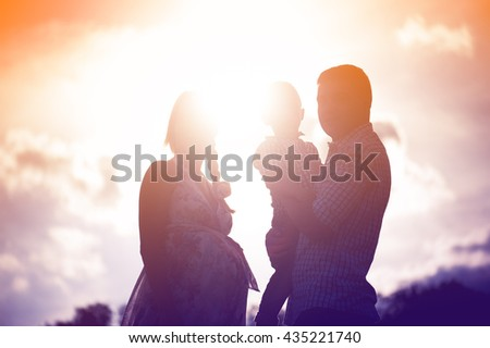 family, silhouette, three people in the evening light.