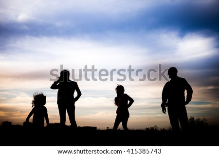 Family silhouettes with sunset lights background