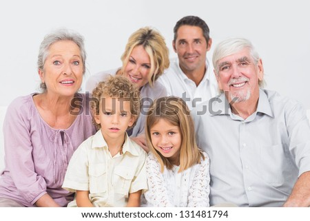 Family sitting and posing for a picture - stock photo