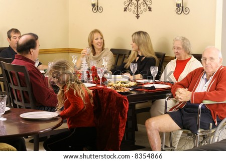 family sitting around the dinner table