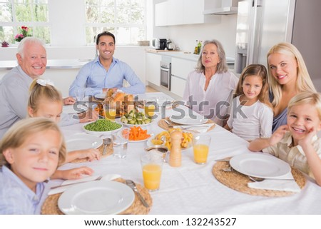 Family sitting for thanksgiving dinner