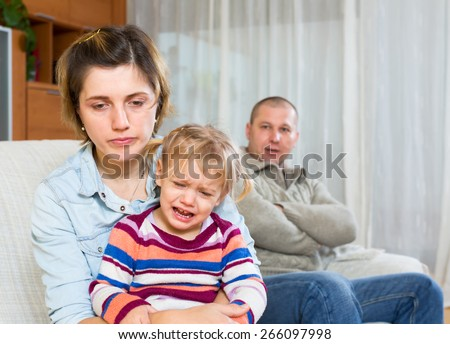 Family sitting on a sofa after a quarell - stock photo