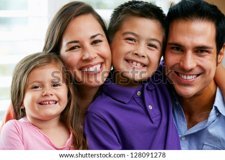 Family Sitting On Sofa At Home Together - stock photo