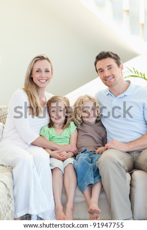 Family sitting on the couch together