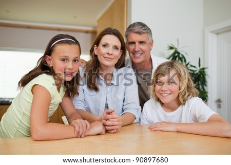 Family sitting together at table