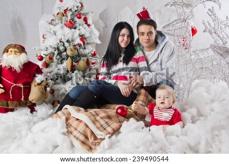Family sitting together in Christmas interior - stock photo