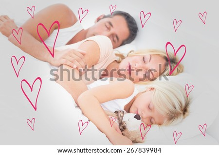 Family sleeping together against red hearts - stock photo