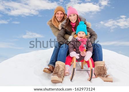 family sliding winter couple enjoying season - stock photo