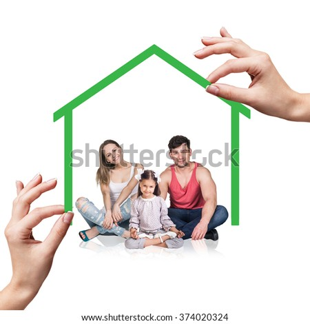 Family stand under green house