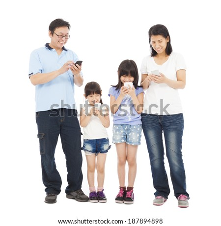 Family standing a row and using smart phone together - stock photo