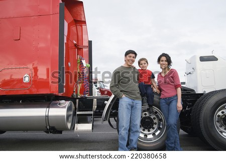 Family standing by their truck - stock photo