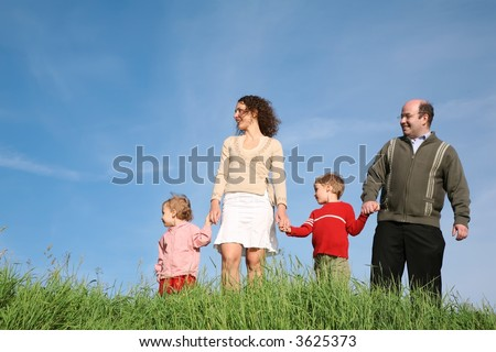 family standing grass