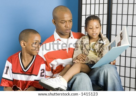 Family story time - stock photo