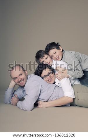 Family studio portrait - stock photo