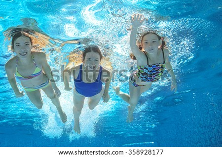 Family swim in pool or sea underwater, happy active mother and children have fun under water, kids sport on family vacation