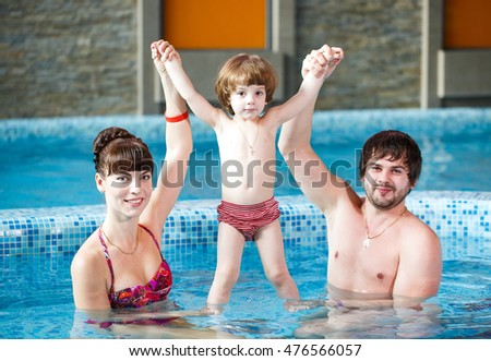 Family swimming in the pool.