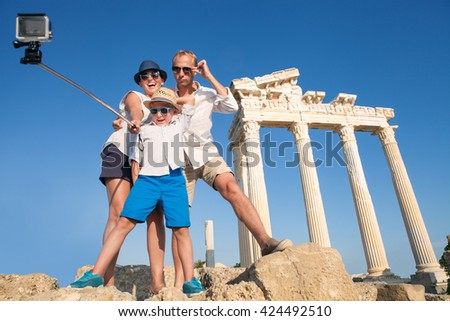 Family take a selfie video on the antique colonnade view Temple of Apollo,Side,Turkey - stock photo
