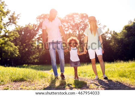 Family taking a walk in nature in a beautiful park