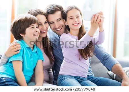 Family taking photo of themselves   - stock photo