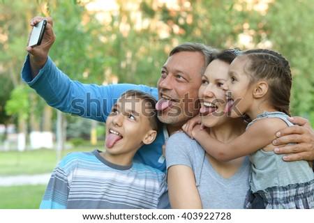 Family taking selfie on  sea - stock photo