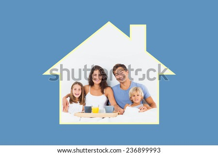Family taking the breakfast on the bed against blue background with vignette