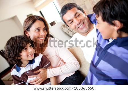 Family talking and a boy telling a story - stock photo