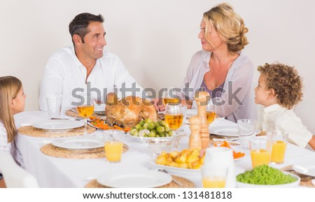 Family talking together before to eat a turkey