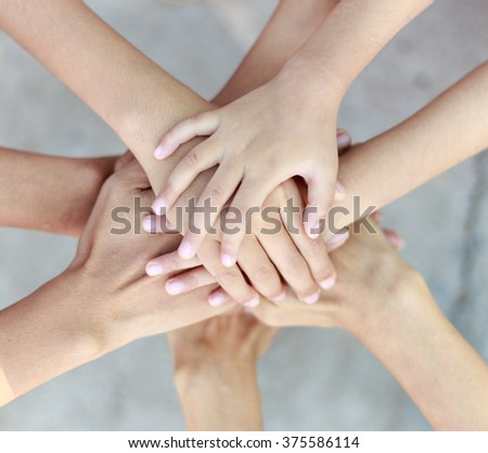 Family teamwork - father,mother and children hands