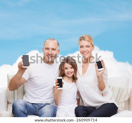 family, technology, advertisement and people concept - smiling mother, father and little girl with smartphones over blue sky and white cloud background - stock photo