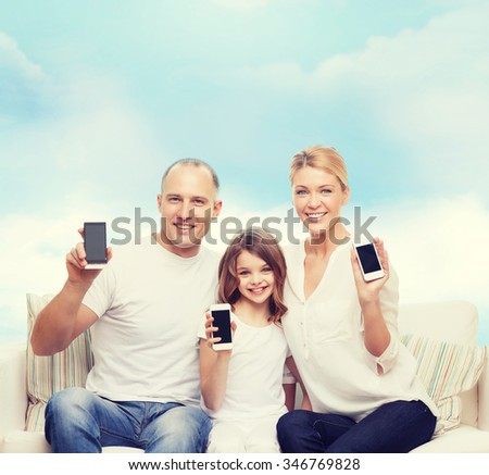 family, technology, advertisement and people concept- smiling mother, father and little girl with smartphones over blue sky background - stock photo