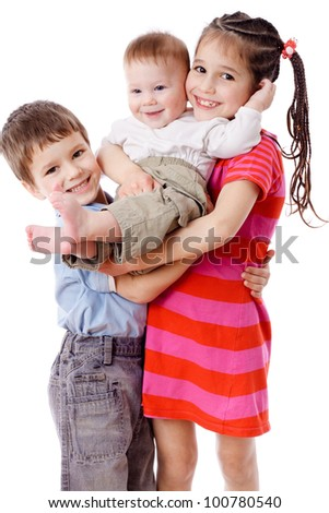 Family - three smiling kids together, isolated on white - stock photo