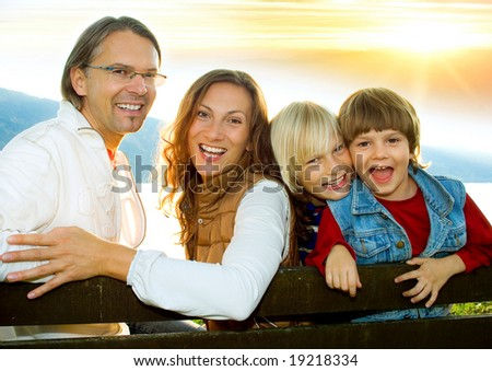 family time 4 / cute family with sunset - stock photo