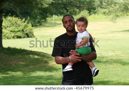 Family Time in Park African American Man Walking with Biracial Child - stock photo