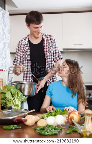 Family together  cooking in domestic kitchen