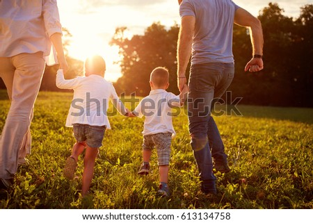 Family together, parents with children back view - concept