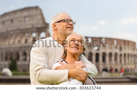 family, tourism, travel and people concept - happy senior couple over coliseum in rome, italy - stock photo