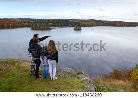 Family trip in the autumn season - stock photo