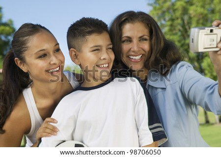 Family Using Digital Camera - stock photo