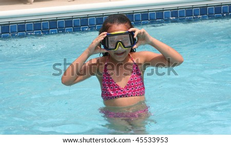 Family Vacation African American Biracial Girl in pool wearing goggles